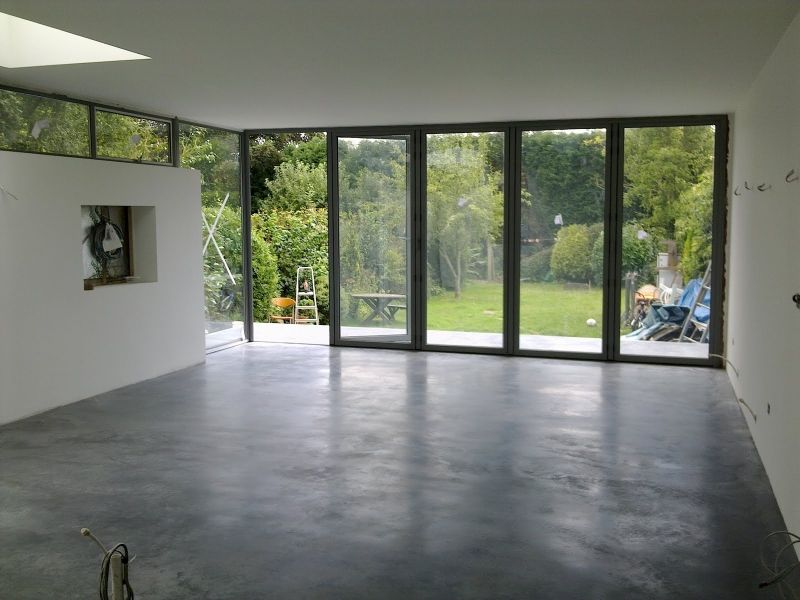 Natural power float concrete floors house oxted for Concrete home contractors